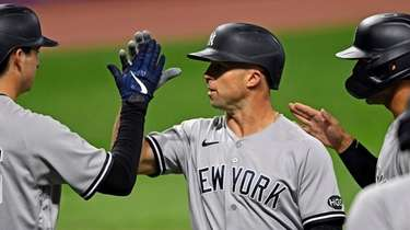 Yankees' Brett Gardner (11) is congratulated by Kyle