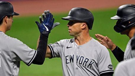 Yankees' Brett Gardner (11) is congratulated by Kyle