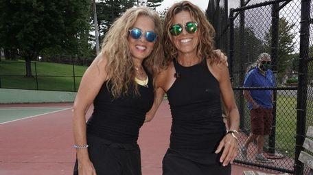 Soozie Turek, left, and Laura Katz play tennis