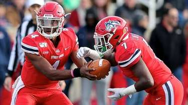 Stony Brook QB Tyquell Fields hands the ball