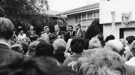 Gov. Nelson Rockefeller, center, announces Sol Wachtler as