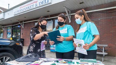 Indira Guillen, 33, from Brentwood, left, receives guidance