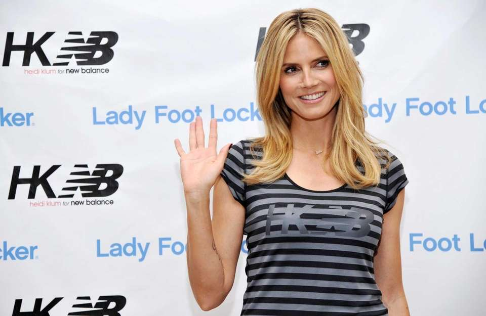 """Project Runway"" host Heidi Klum waves to photographers"