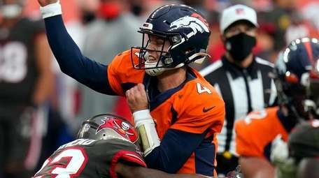 Broncos quarterback Brett Rypien is hit by Buccaneers