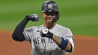 The Yankees' Gleyber Torres celebrates after hitting a