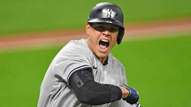 Gio Urshela of the Yankees tosses his bat