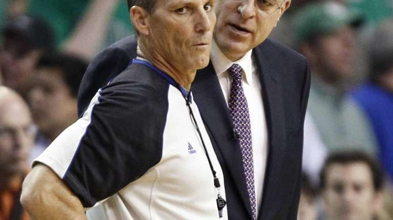 Los Angeles Lakers coach Phil Jackson questions referee