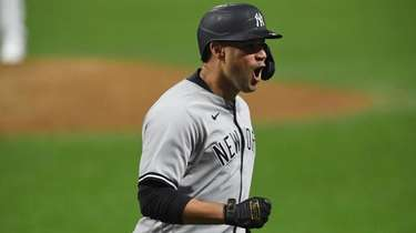 The Yankees' Gary Sanchez reacts after hitting a
