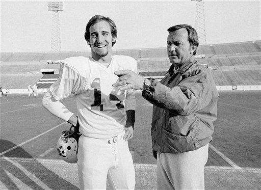 New England Patriots coach Chuck Fairbanks, right, makes