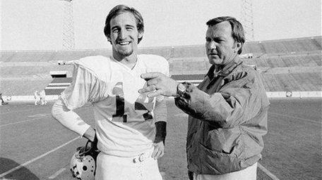 New England Patriots coach Chuck Fairbanks, right, makes