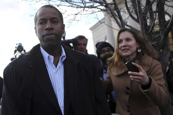 Sen. Malcolm Smith leaves federal court in White