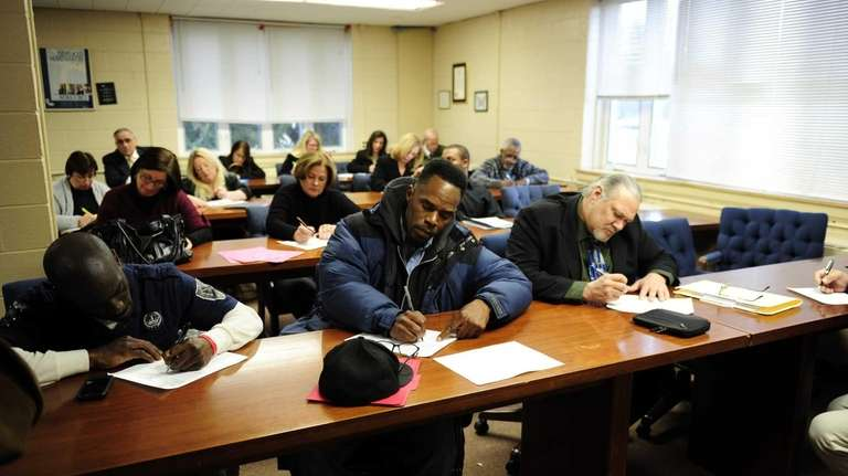 Job-seekers fill out forms at the Suffolk One-Stop