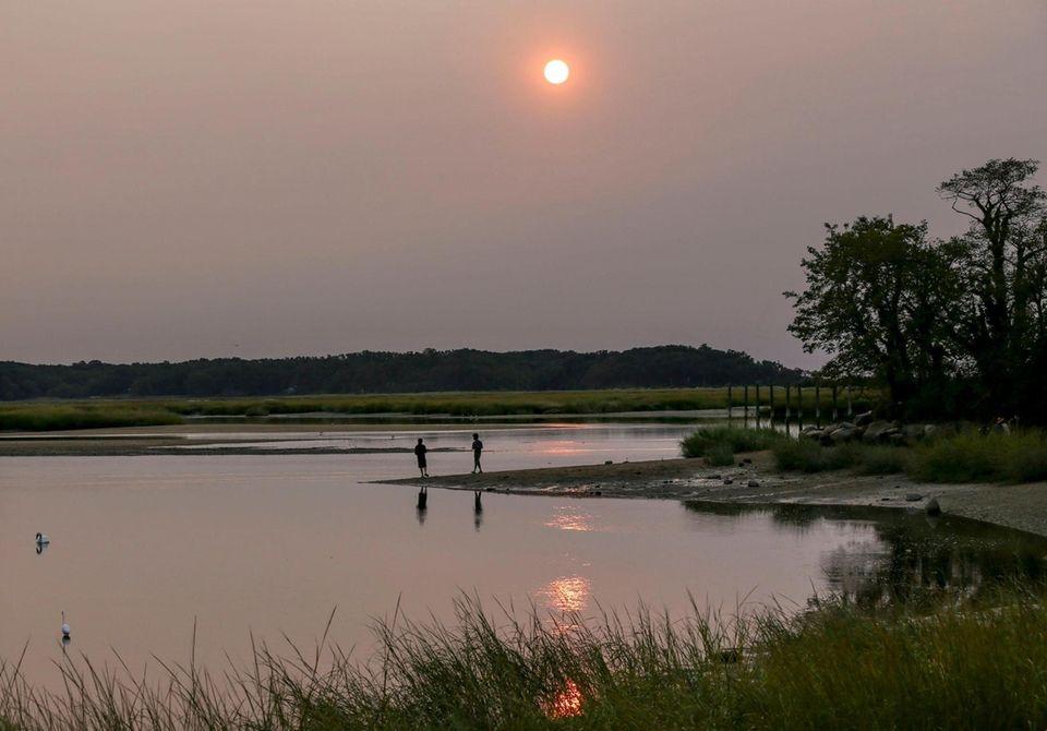 As seen from Stony Brook Harbor, the sun