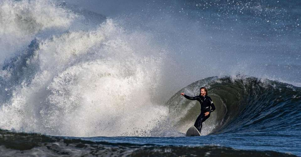 A surfer riding a large wave at Lido
