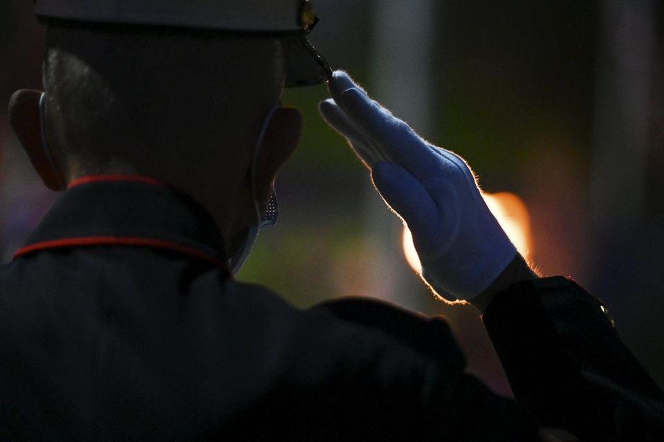 U.S. Marine veteran Paul Masi, salutes during a