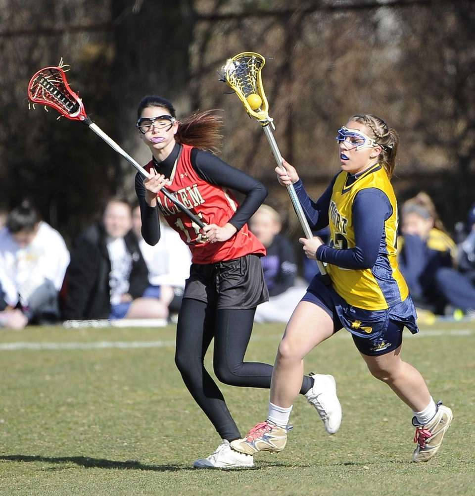 Northport midfielder Emily Columbus is defended by Sachem