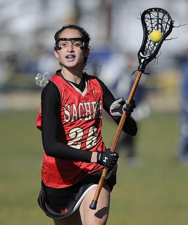 Sachem East's Kaitlyn Shanahan runs the ball against