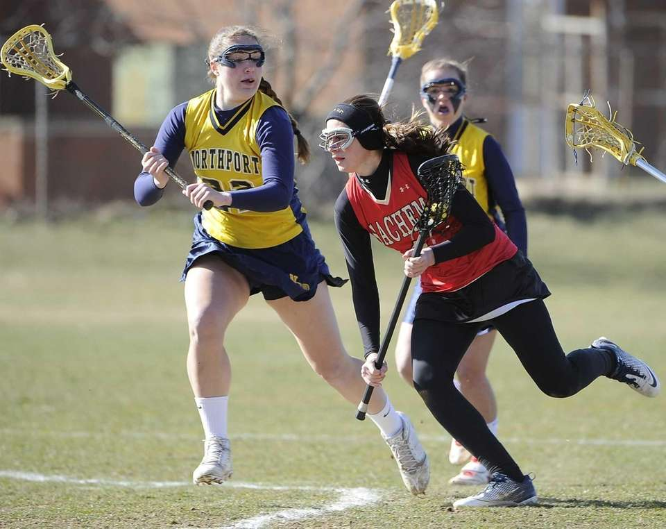 Sachem East's Kaitlin Trombetta is defended by Northport