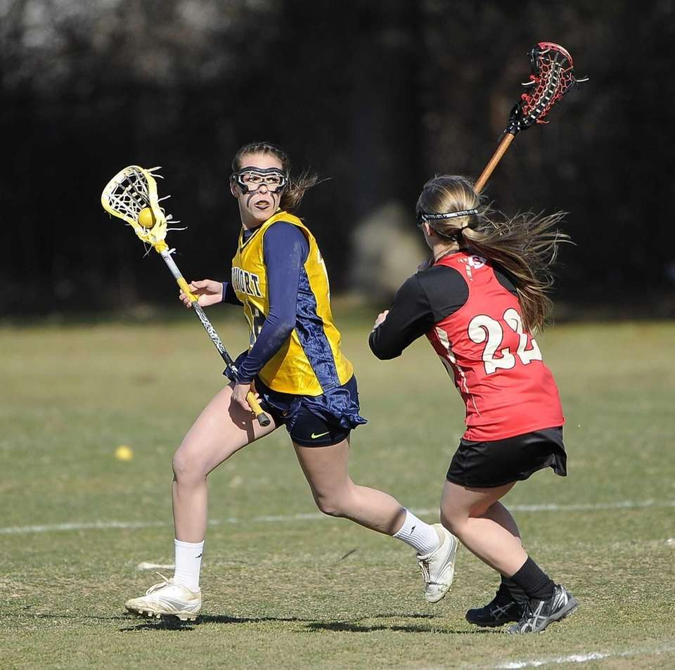 Northport midfielder Allie Pavinelli is defended by Sachem
