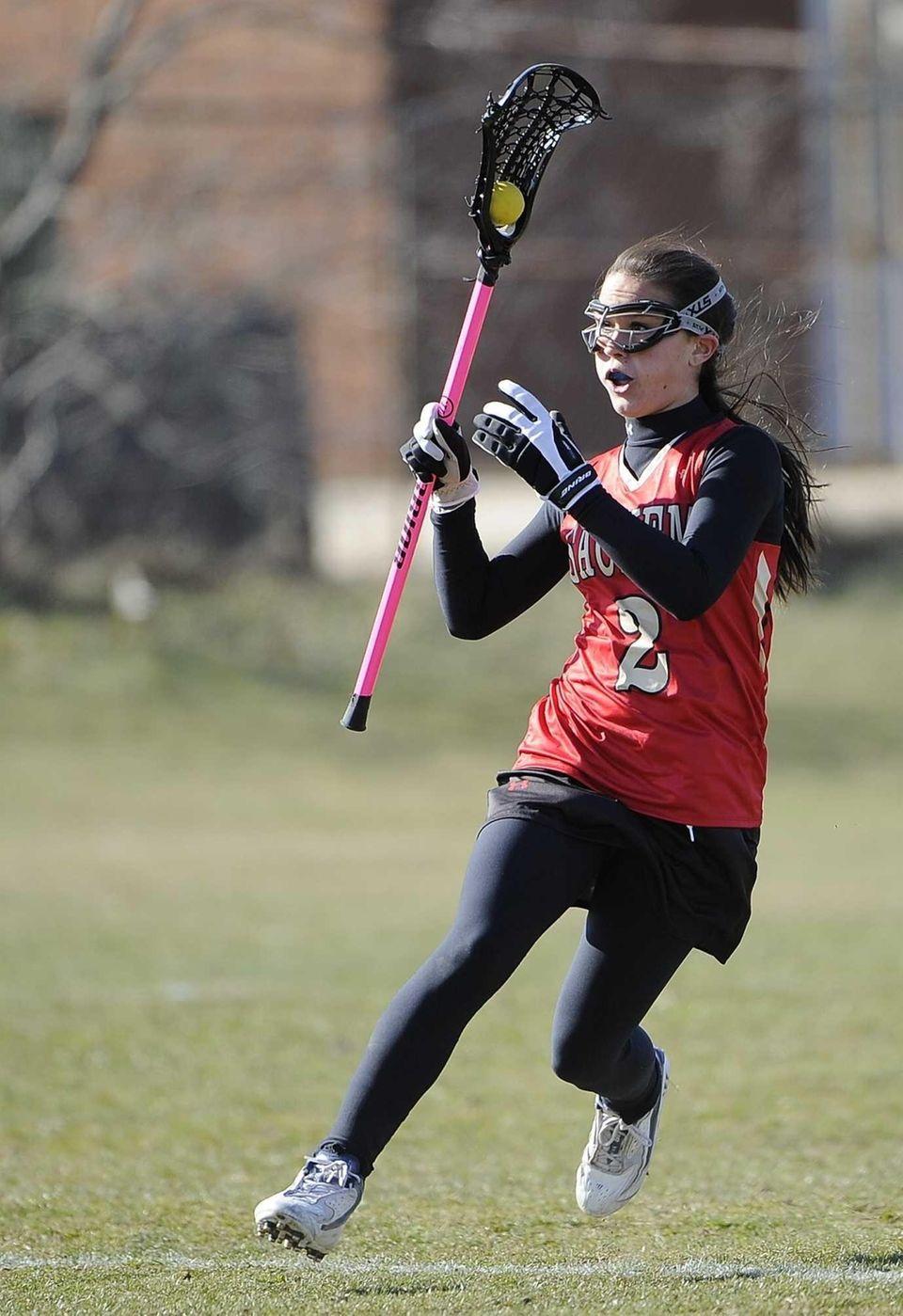 Sachem East's Cara Trombetta runs the ball against