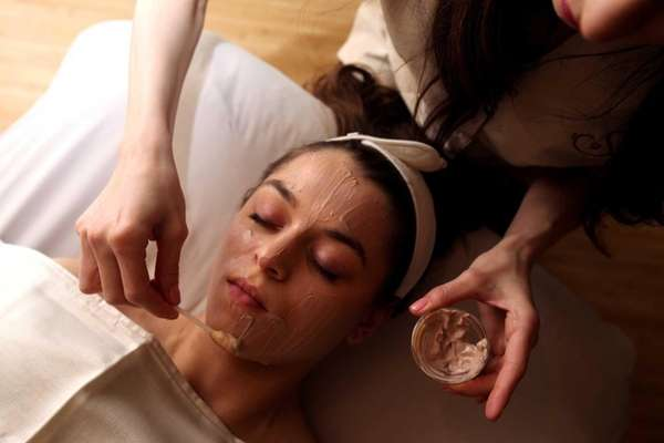 At Salon Blue in Mineola, an esthetician swabs