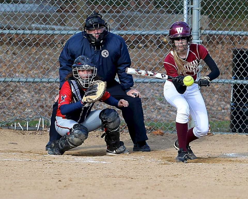 Walt Whitman's Valerie Abbene squares to bunt during