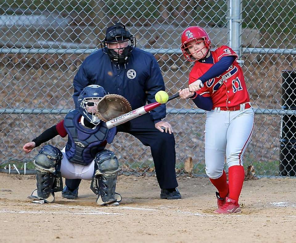 Smithtown East's MacKenzie Buckley drives a pitch during