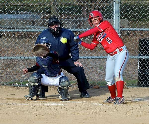 Smithtown East's Angela Pagano strokes a hit to
