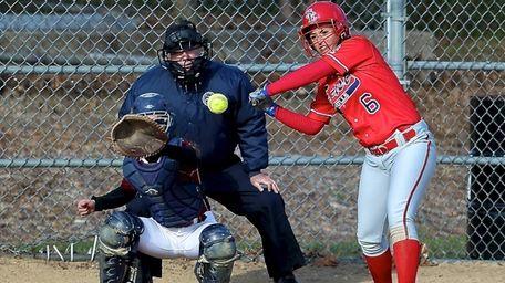 Smithtown East's Angela Pagano strokes a hit to