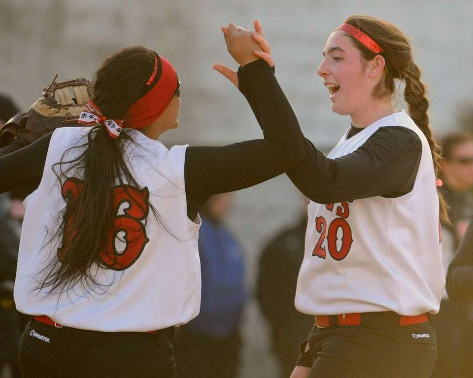 Island Trees pitcher Alannah Basile, right, celebrates with
