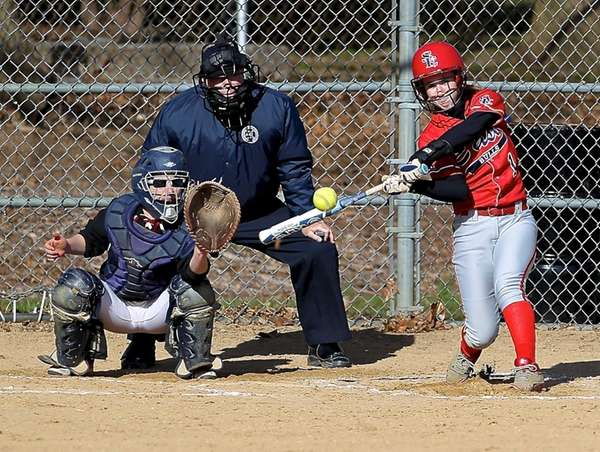 Smithtown East's Kristina Hussey drives a pitch to