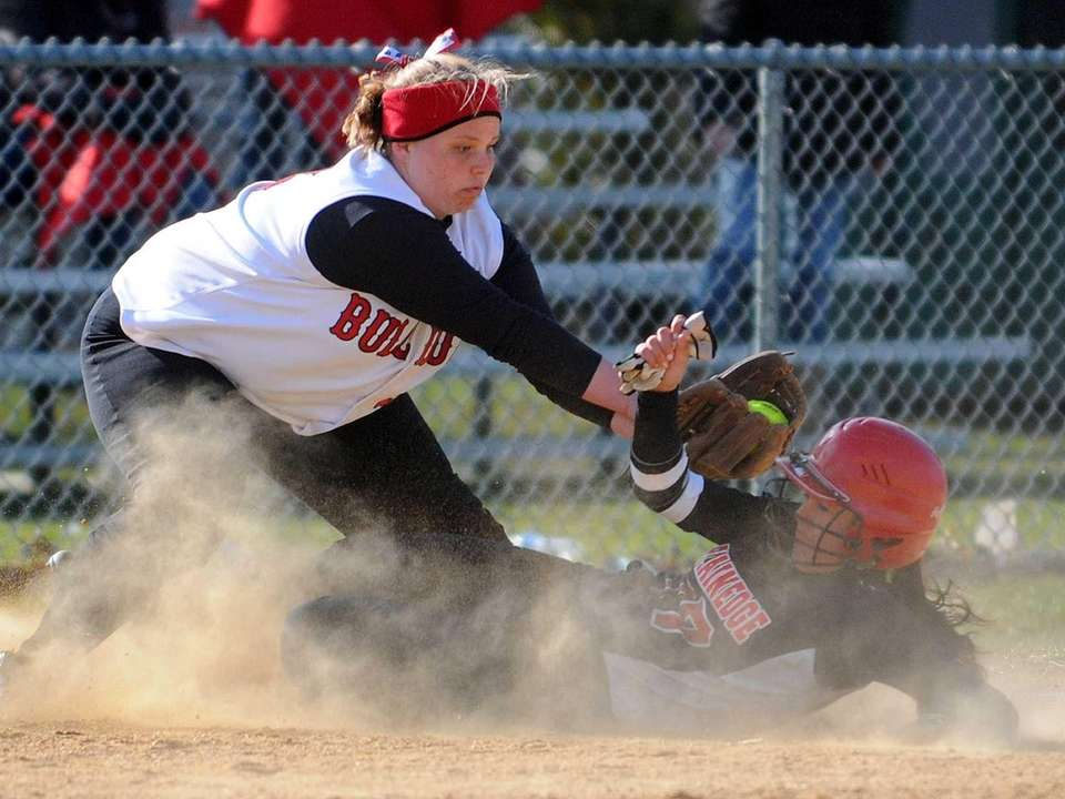 Island Trees 3B Tori Tedeschi, left, tries to