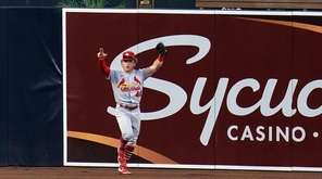 St. Louis Cardinals center fielder Harrison Bader, bottom,