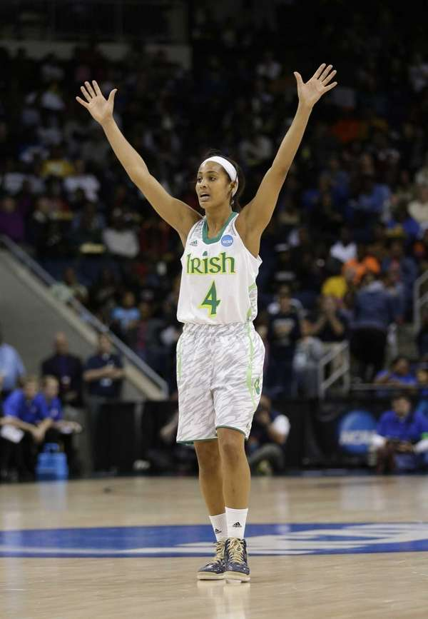 Notre Dame guard Skylar Diggins celebrates a teammate's