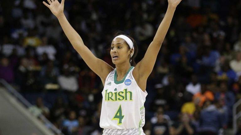 Notre Dame guard Skylar Diggins celebrates a teammate's