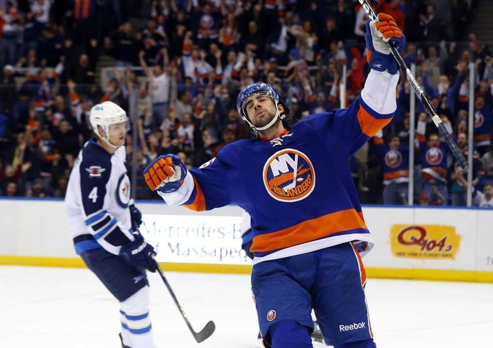 Matt Moulson of the Islanders celebrates his third