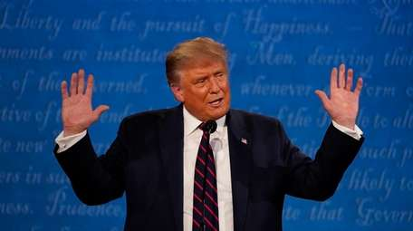 President Donald Trump gestures while speaking during the