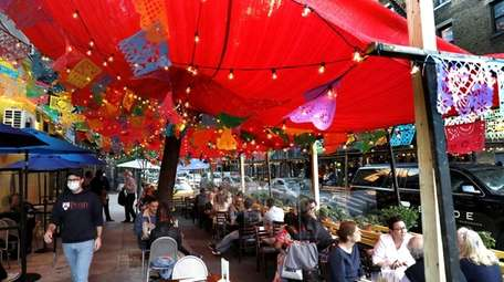 Diners outside in Brooklyn Tuesday. A report from