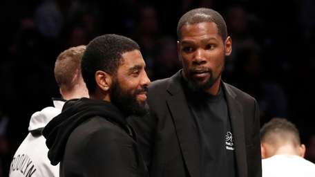 Kyrie Irving, left, and Kevin Durant of the