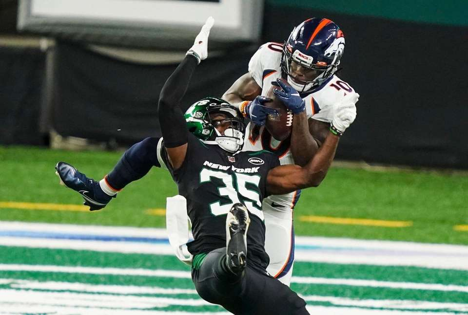 Denver Broncos wide receiver Jerry Jeudy (10) fights