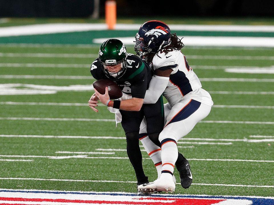 Alexander Johnson #45 of the Denver Broncos sacks