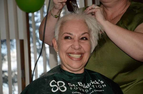 Cancer survivor Karen Melito, of Westbury, shaves her