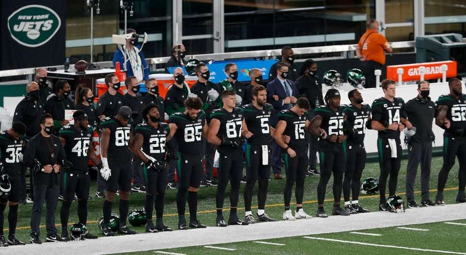 Members of the New York Jets lock arms