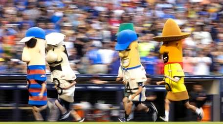 The Milwaukee Brewers' Famous Racing Sausages mascots during