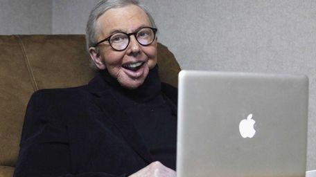 Pulitzer Prize-winning movie critic Roger Ebert works in