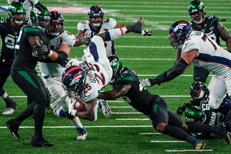 Denver Broncos running back Melvin Gordon (25) rushes