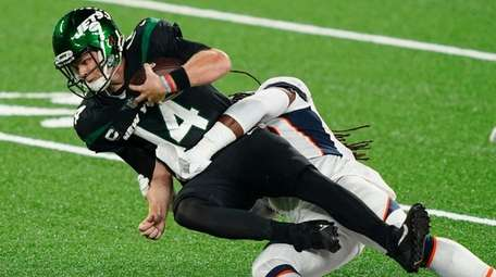 Jets quarterback Sam Darnold is sacked by the