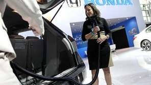 A Honda Motor Co. representative demonstrates the vacuum