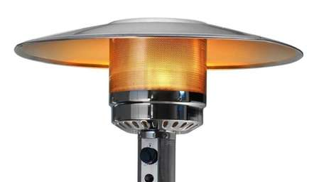 An outdoor patio propane heater with glowing flame