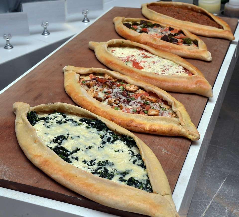 Turkish-style pizzas known as pides at the counter
